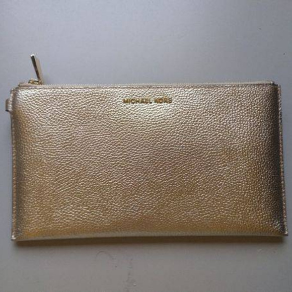 Michael Kors Handbags - Michael Kors Mercer Leather clutch bag (Gold)